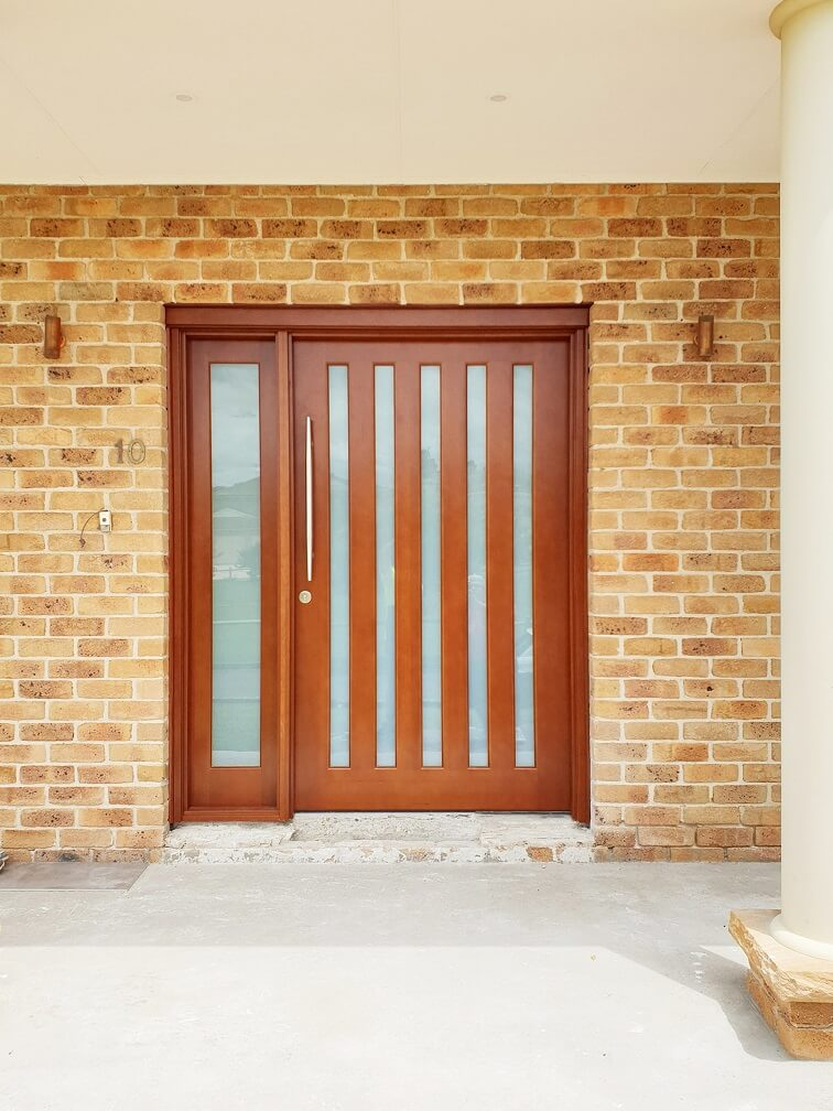Frosted Glass Entry Door with matching sidepanel stained dark maple with vertical glass panels