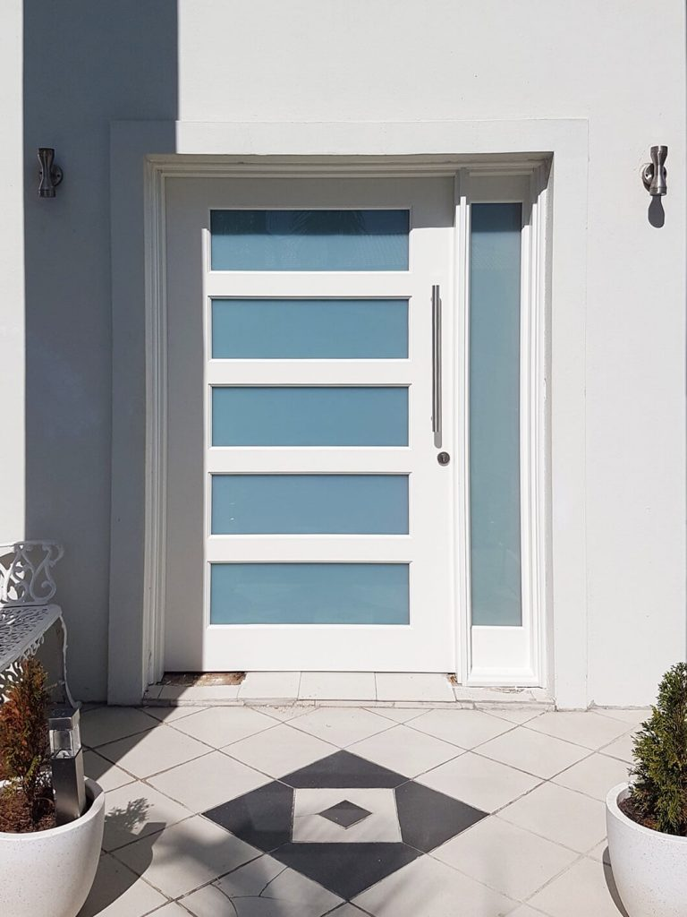 wide frosted glass entry door painted white with matching sidepanel