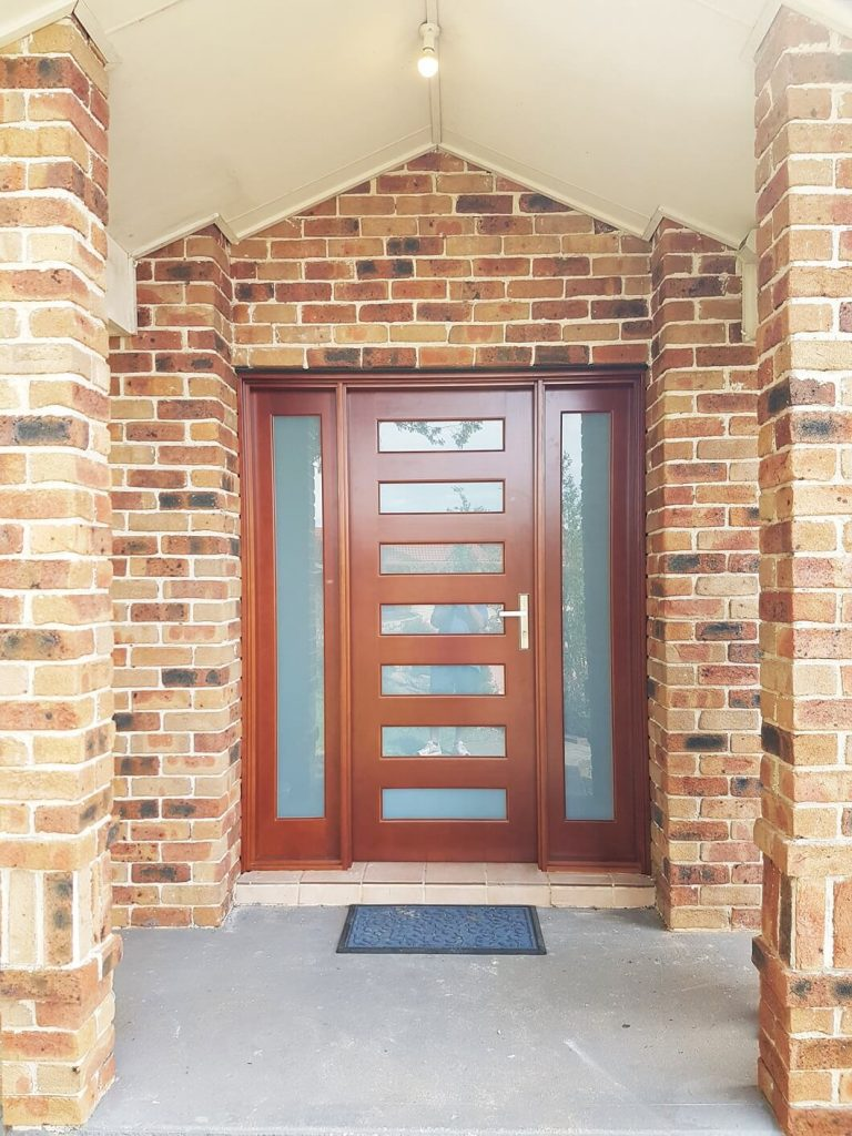 frost glass entry door with two sidepanels on either side of the door