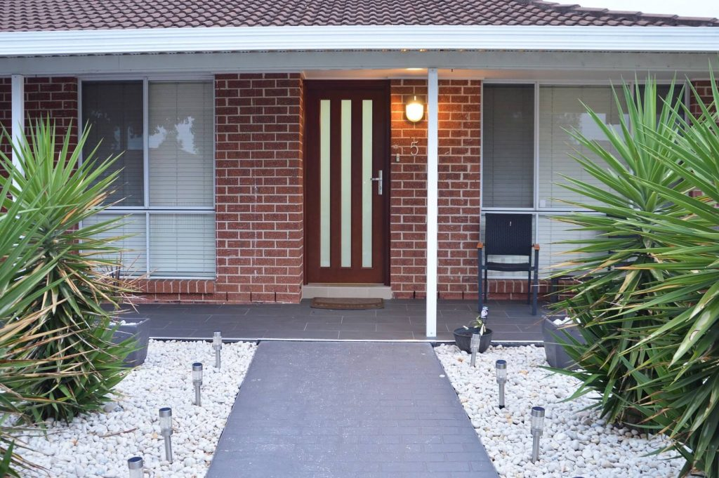 frosted glass front door with vertical panels of safeglass