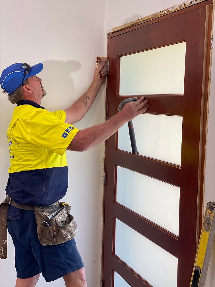 frosted glass front door being installed by doors plus carpenter