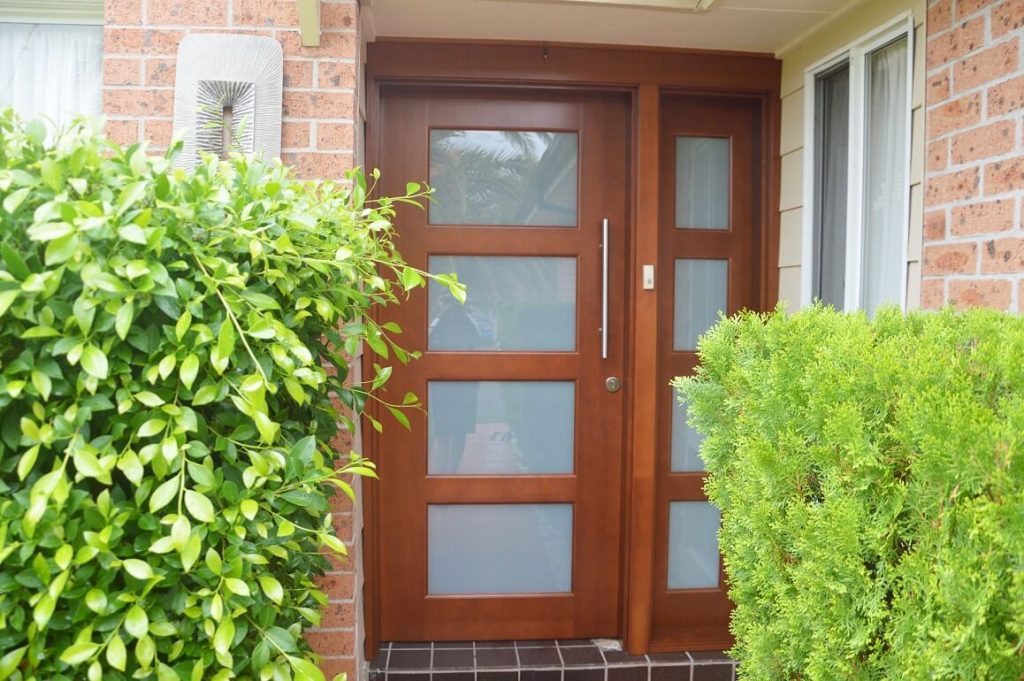 frosted glass front door with matching side panel in solid timber